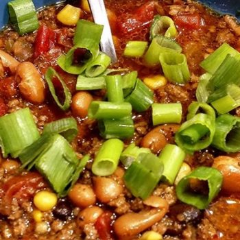 easy taco soup recipe topped with green onions.