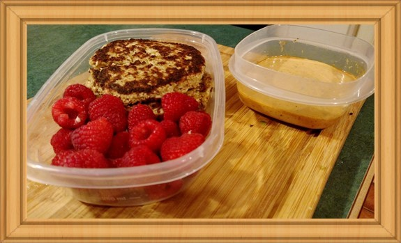 crab cake lunch with fresh raspberries and tartar sauce