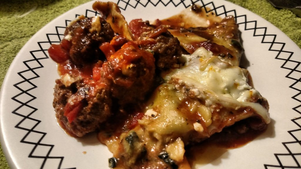 easy bake ravioli with Italian sausage served on a plate