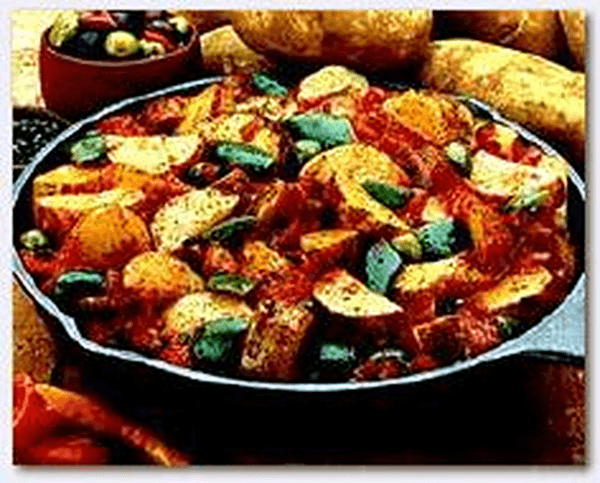 Spanish potatoes recipe with capers in cast iron fry pan
