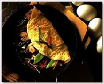 stir fry omelet in pan.