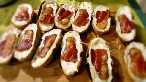 Ultimate twice baked potatoes filled and topped with bacon
