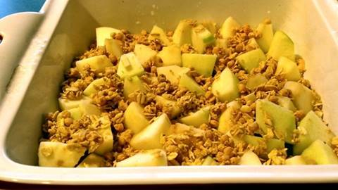 3 ingredient Apple Crisp granola on apples in baking dish