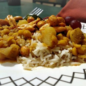 Peanut chicken stir fry on bed of rice served on a plate