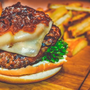 chorizo burger topped with cheese and peppers
