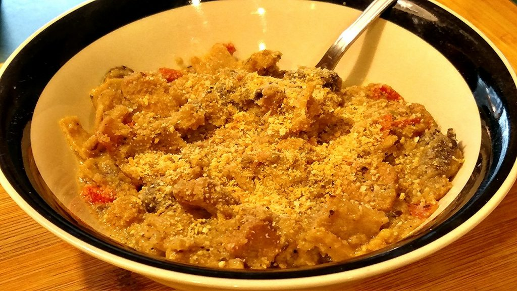 homemade tuna noodle casserole served hot in a bowl topped with breadcrumbs