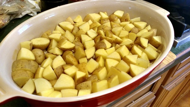 Cut potatoes and put in baking dish