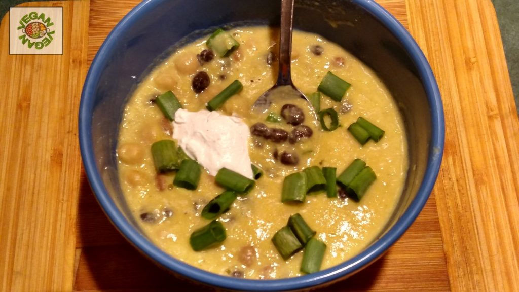 vegan corn chowder in a bowl with added toppings
